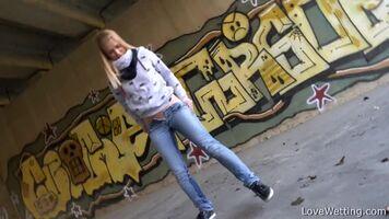 Violeta Wets Her Jeans Under A Bridge